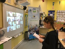 Y6 pupil speaking with friends in Israel over Zoom call